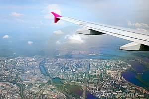 view-airplane-wing-city-beneath